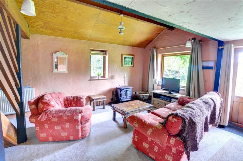 The sitting room is comfortably furnished and decorated in terracotta shades