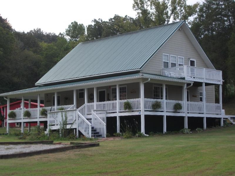 Country Time Escape-Enjoy the covered wrap around porch with swing and chairs