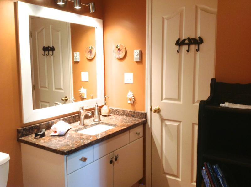 Sunrise Room's bathroom - ensuite. Granite Countertops. Tile floor, standup shower.  Renovated