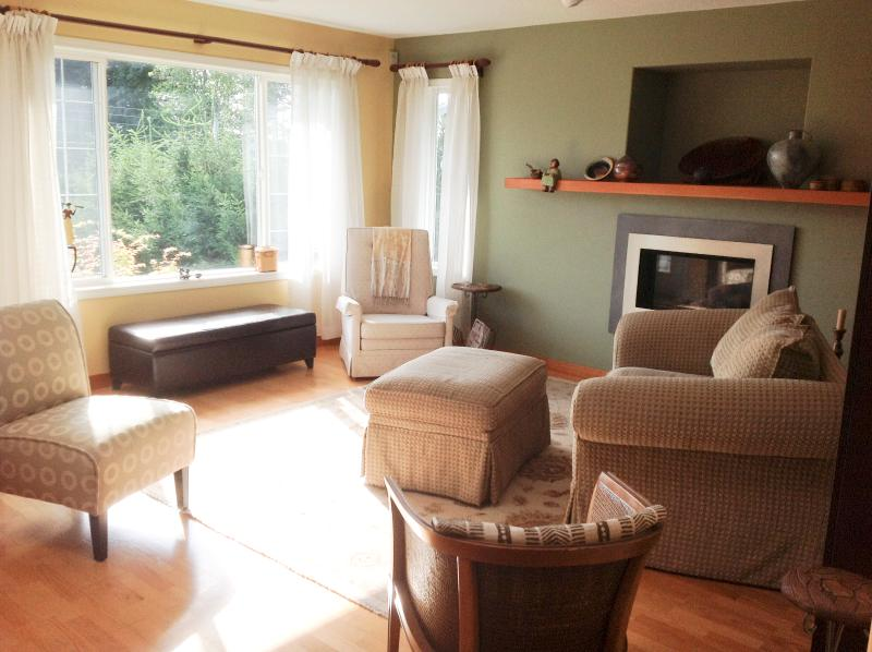 Living Room - open concept, ocean views and mountain views, watch the sunrise, or head to the deck
