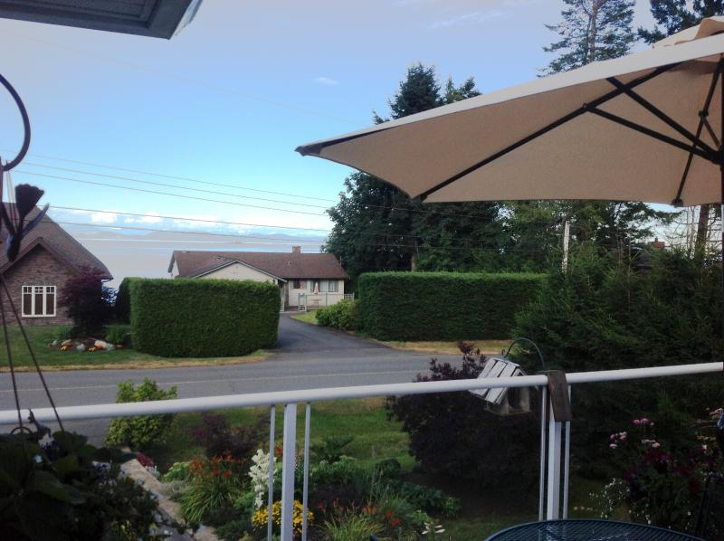From our deck where we will serve you breakfast ( weather permitting).  Ocean and Mountain Views