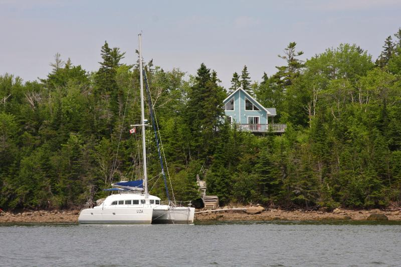 our sailing catamaran in front of Bluenose House, available in 2015 as well