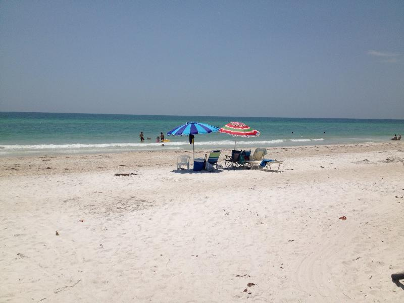 Wide, uncrowded, sandy beach and calm cool water