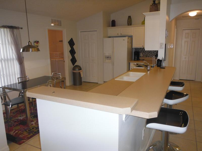 Kitchen with Dining area and Breakfast Bar.