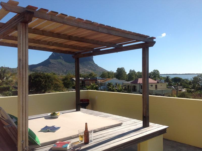 Beautique Studios shared  Roof Terrace with stunning views to Le Morne.