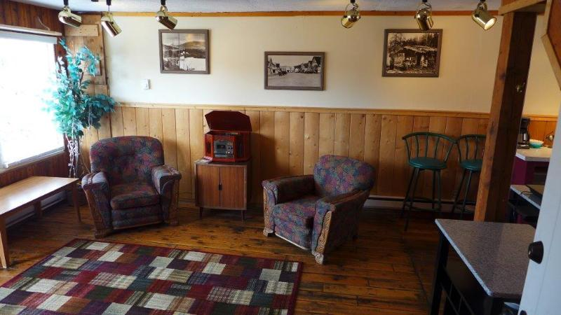 Living Room with photos of the town from its heyday.