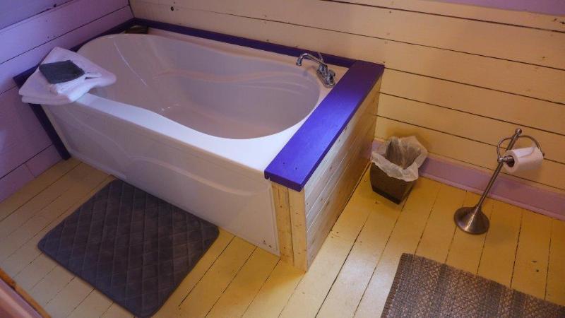 Deep Soaker Tub in a quaint original installation!