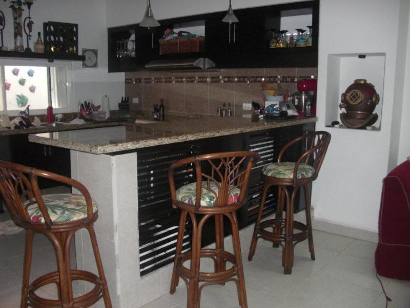 bar overlooking kitchen
