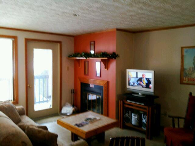 Living Room with Fireplace & Flatscreen TV