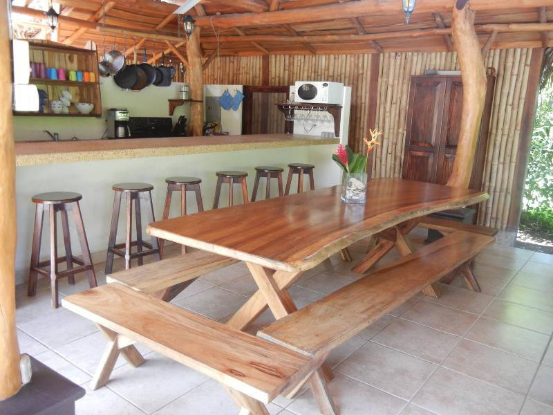 Dining room table in the Rancho seats up to 14 people plus six counter stools