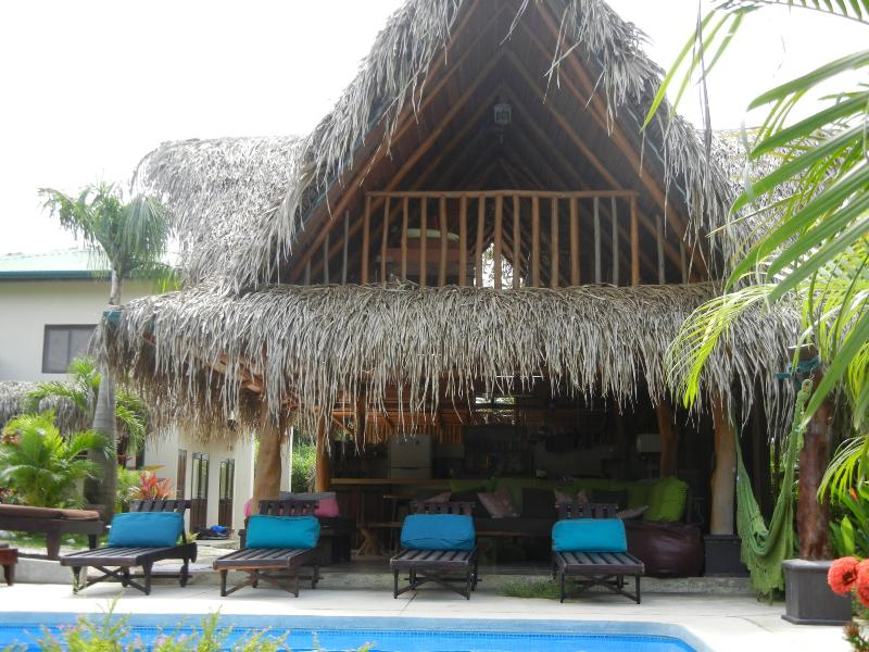 The Rancho pool area includes 4 cushioned lounge chairs and 4 outdoor day beds