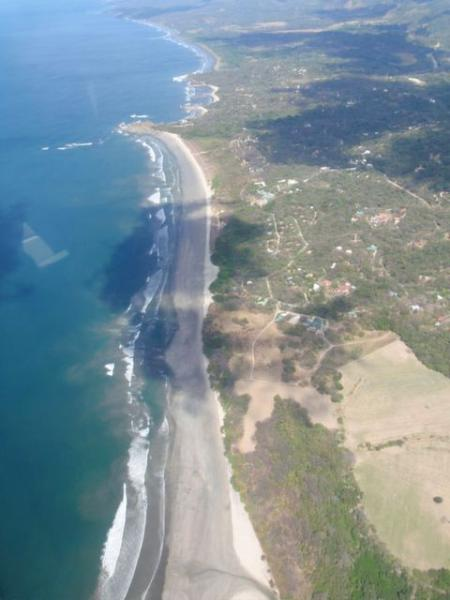 Aerial view of Guiones Beach Club - home is last house atop of a small knoll