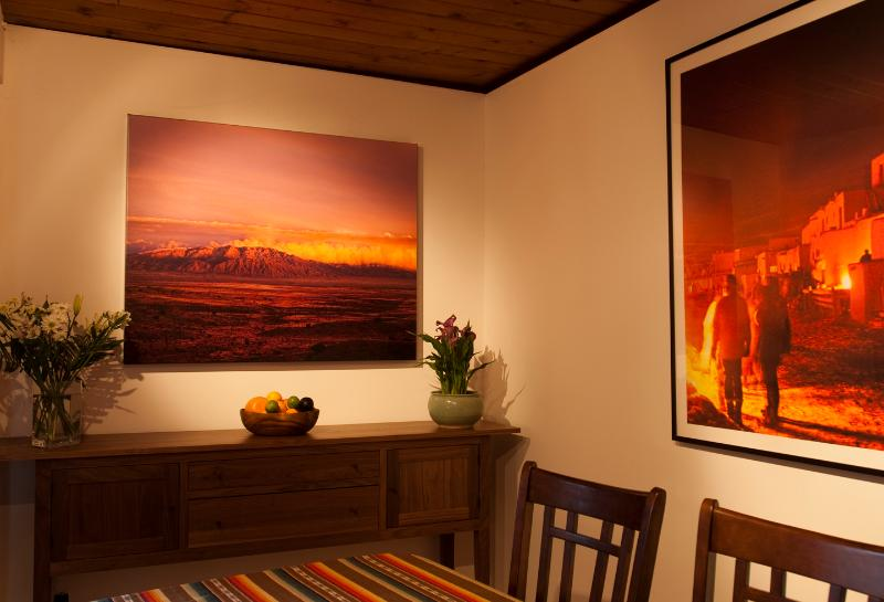 There are original photos printed on canvas hanging in the dinning room.