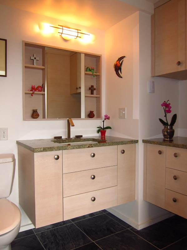 The bathroom is equipped with a walk in shower as well as a full size washer and dryer.