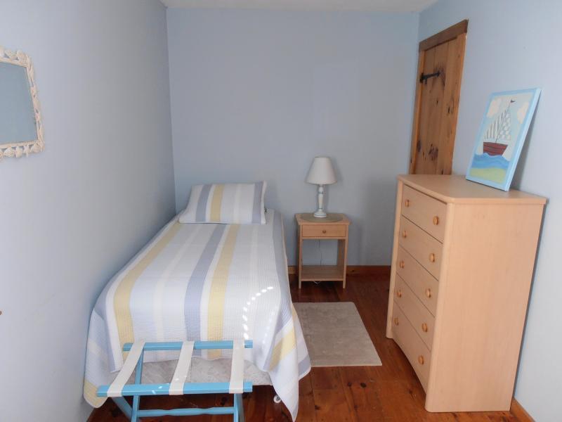 Twin Bed, Ceiling Fan, TV