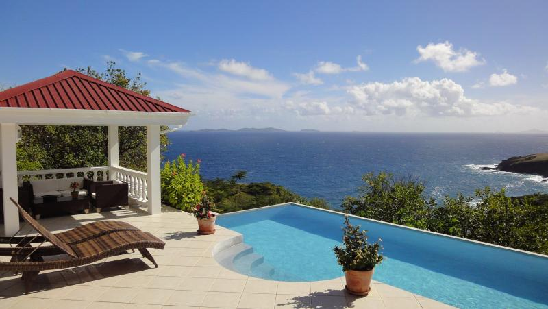 Pool deck, gazebo, and view to Mustique