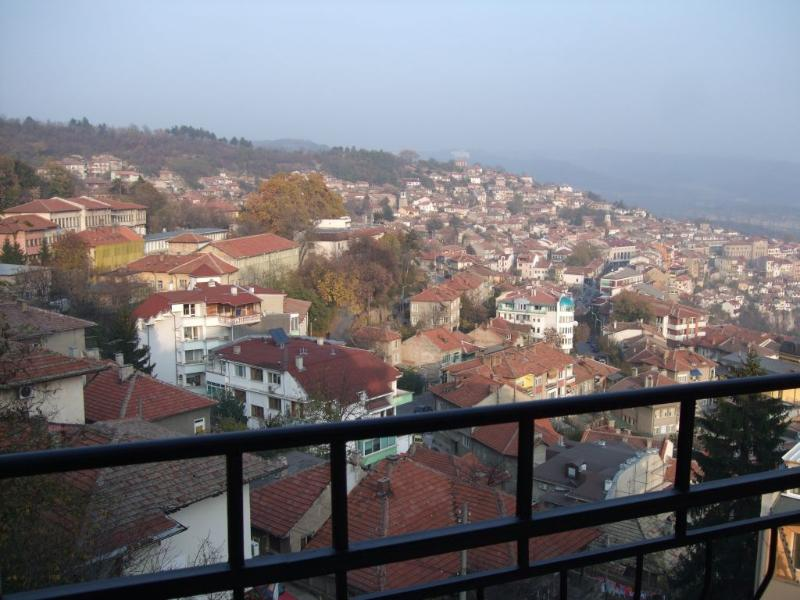 view from balcony of the old town, Tsaravets medieval fortress and the distant hills of Arbanassi