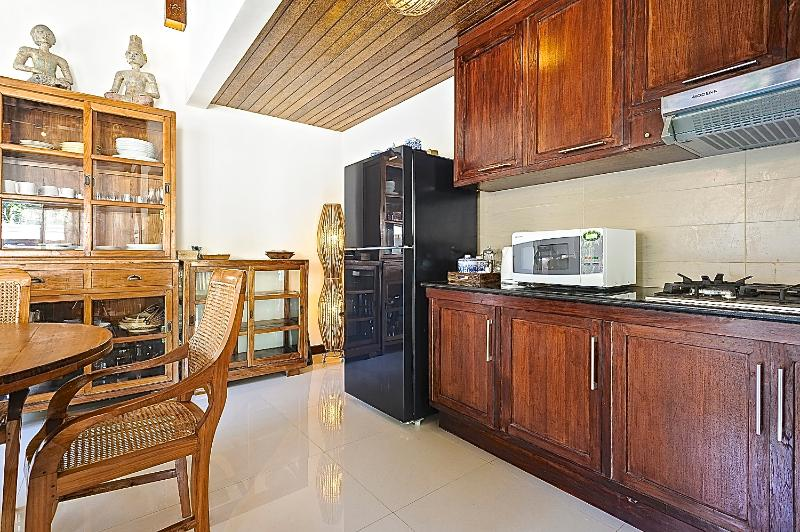 KITCHEN AREA WITH MICROWAVE AND GAS TOP BURNER