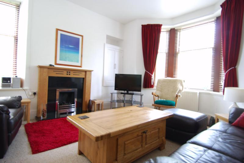 Bright spacious living room with double bed settee