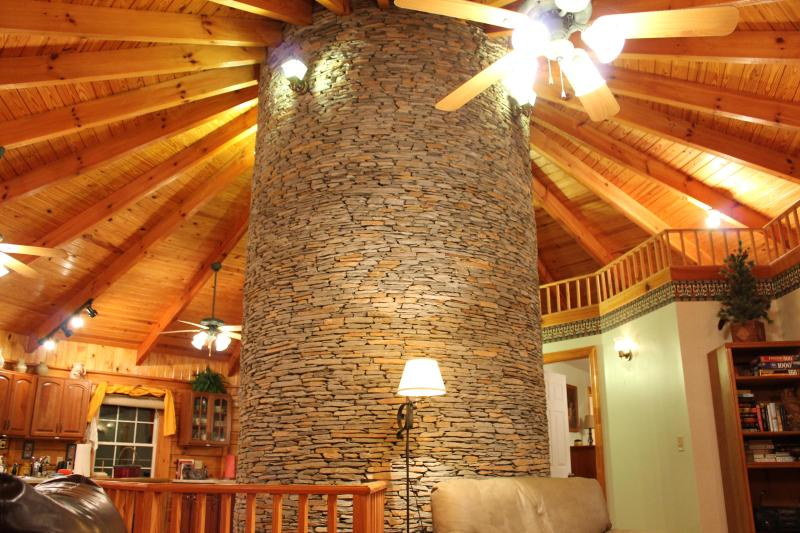 Great stone fireplace is the focal point of the interior