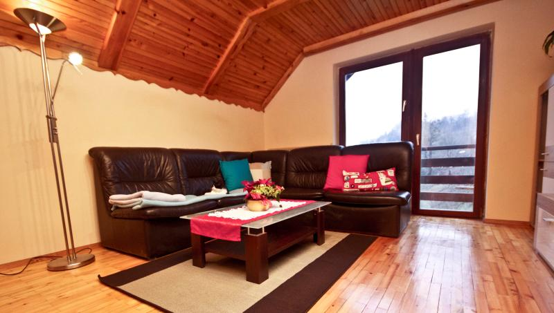 Living room with access to private balcony with a view of Julian Alps.
