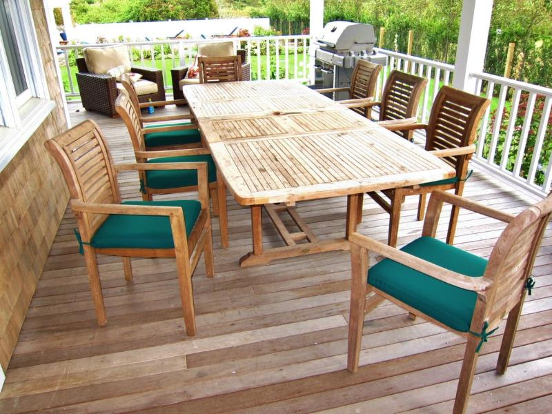 Outdoor dining table under covered porch