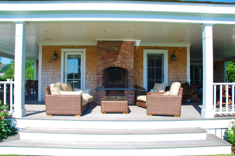 Outdoor living area with fireplace