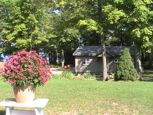 Side view of Cabin , Lake to the left