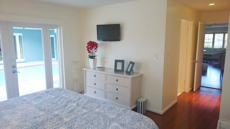 Master Suite Bedroom - King sized bed - direct access to courtyard and pool