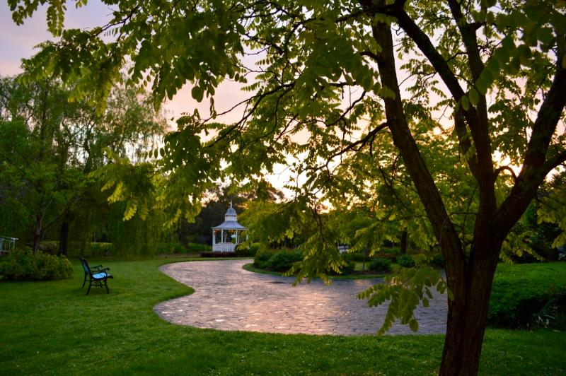 Follow meandering garden paths to the gazebo on the lake