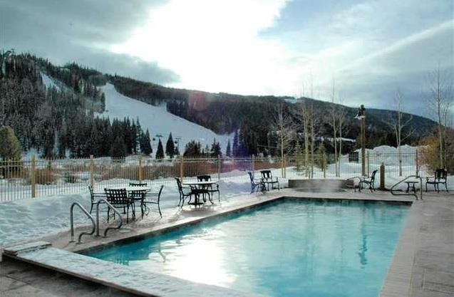Outdoors has 2 hot tubs, heated pool, and gas grill with views of the slopes.