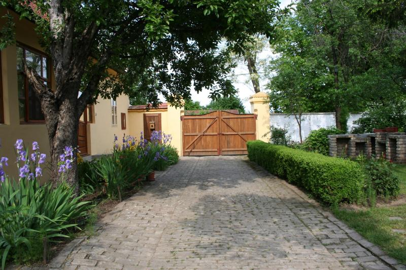 Private garden has driveway and gate