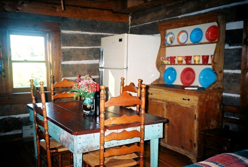 Kitchen/eating area with antique farm table for 4 & dish buffet