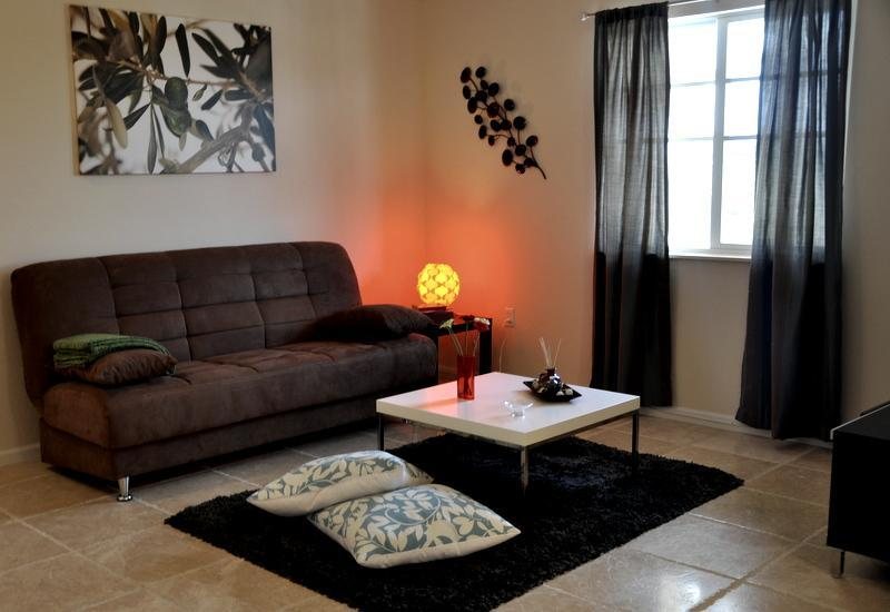 Spacious living room area with a sofa bed and 42 inch TV