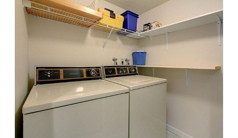 Separate Laundry room with full size washer and dryer, and room for all your cleaning supplies.