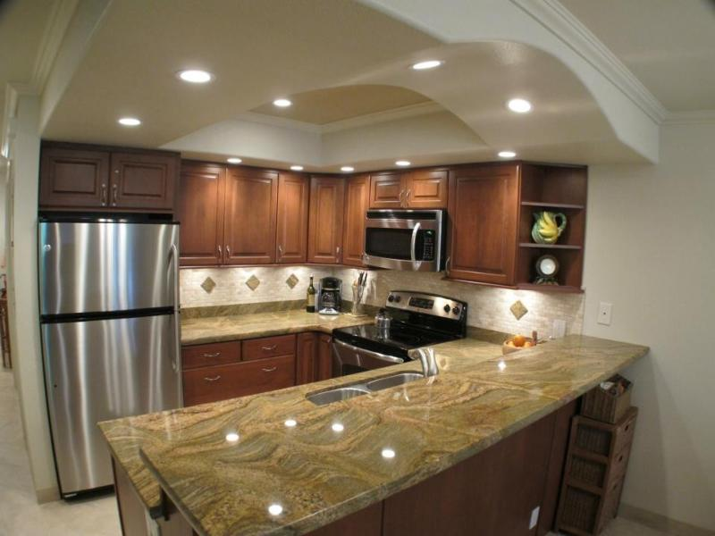 Full view of kitchen with accent ceiling