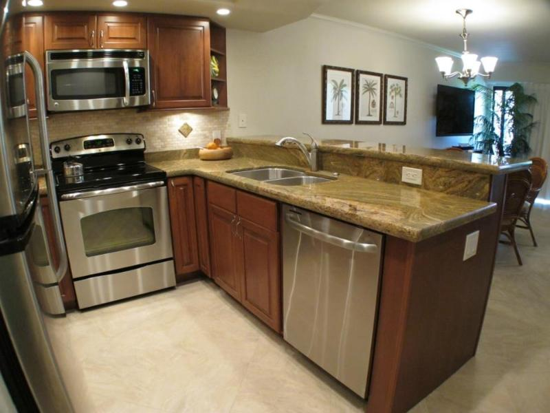 Brand new kitchen with cherry cabinets and stainless steel appliances