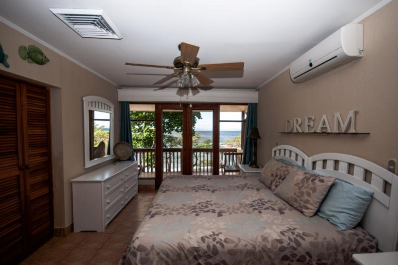 Master bedroom with a balcony and three piece ensuite