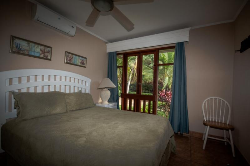 Smaller guest room with a comfortable queen soze bed