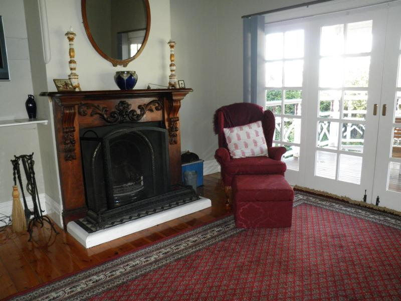 Lounge room, fire and easy chair