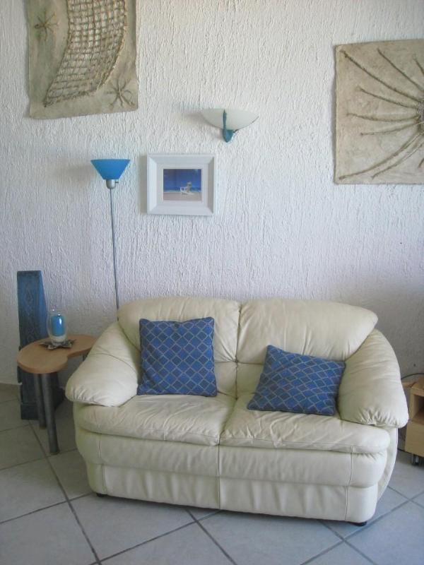 Love seat in living room.