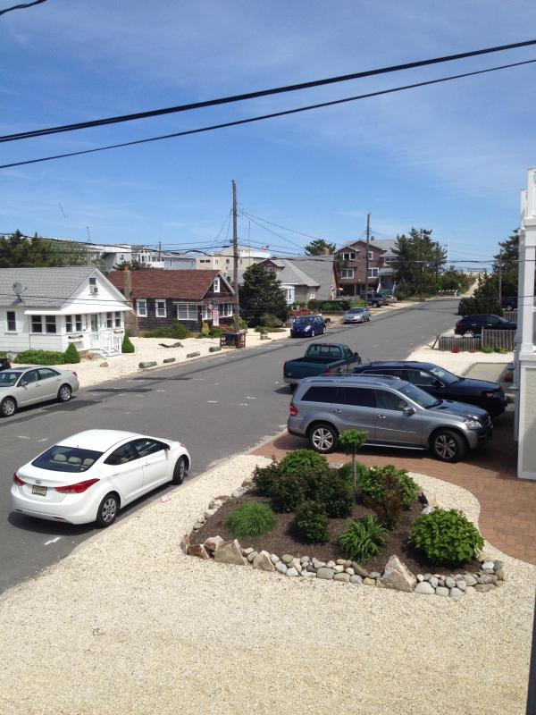 View looking up the block to the beach from front of house