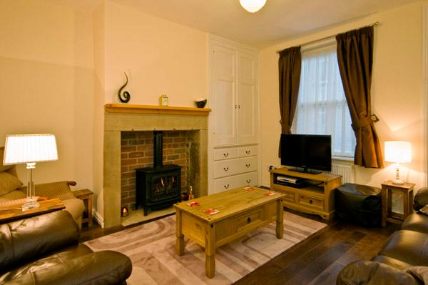 Lounge area with cosy gas fire, flat screen TV & Blueray player free WiFi