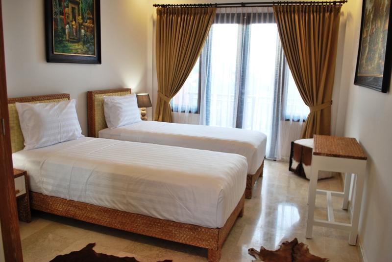 Chambre 2 avec lit King-Size - convertible à deux lits simples
