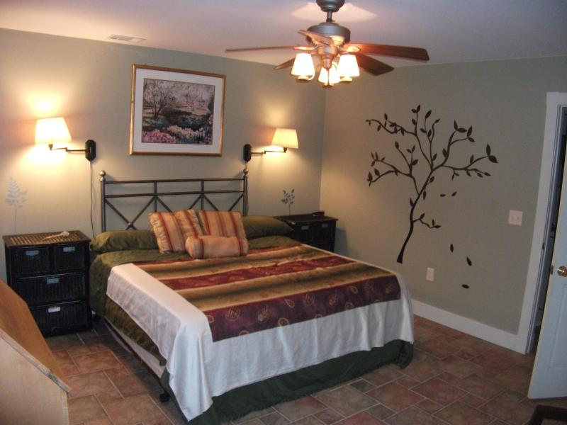 This one bedroom cottage is spacious and features a king sized bed.  Our guests rave about this bed.