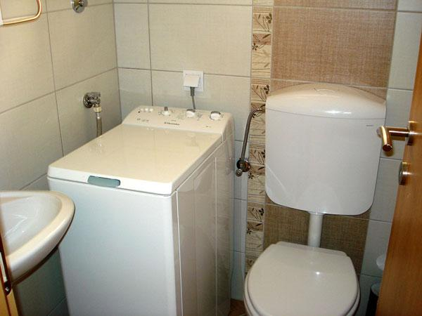 Small toilet with wasching machine