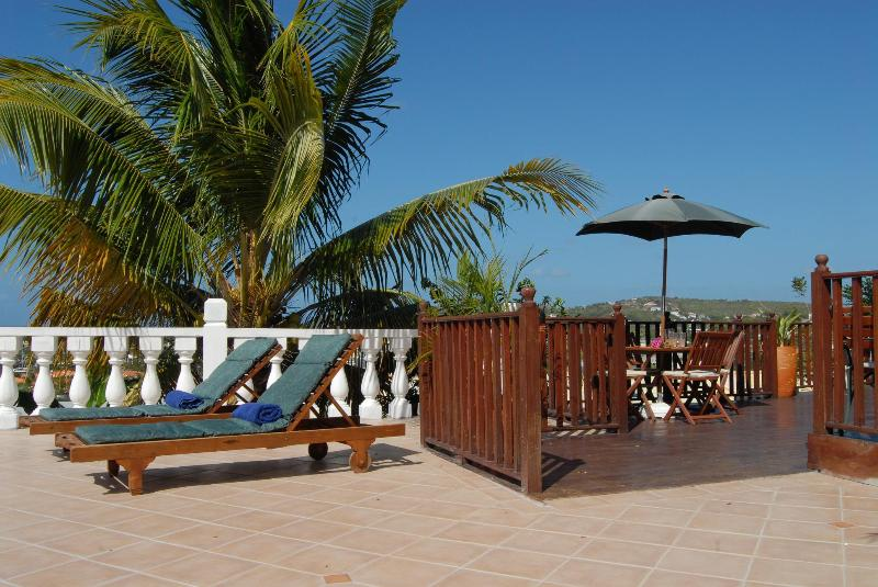 Relax in the beautiful Caribbean surrounds and even pick your own coconuts.