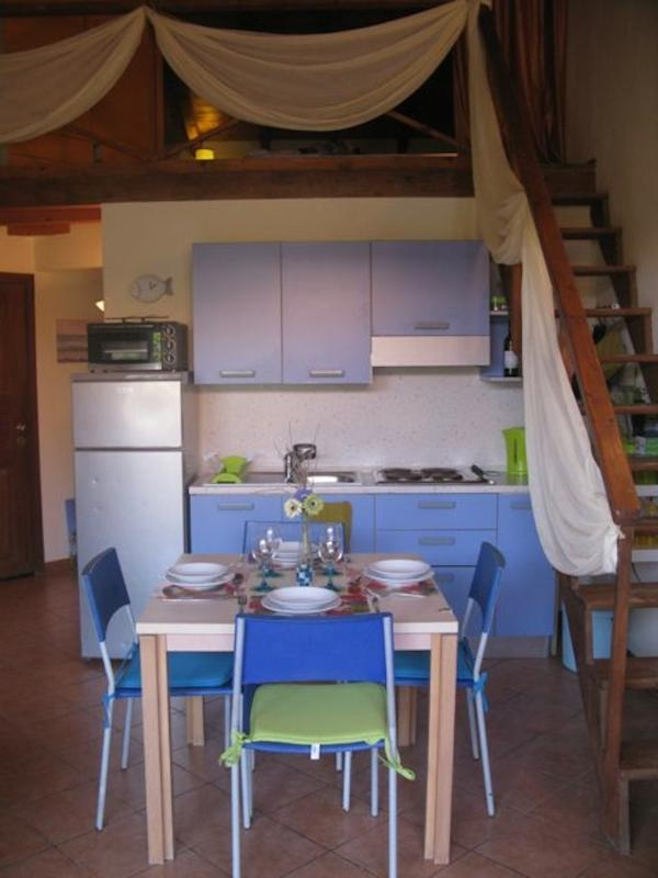 The kitchen area and dining table