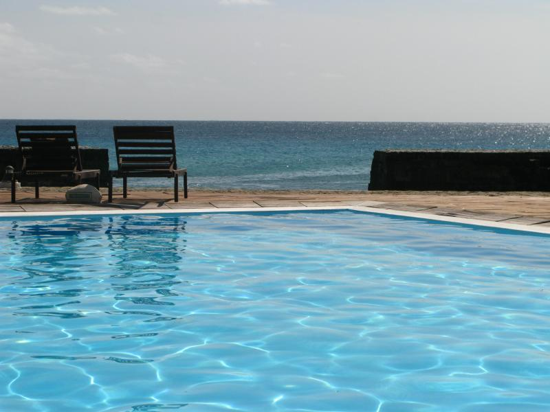 The swimming pool complete with a sea view