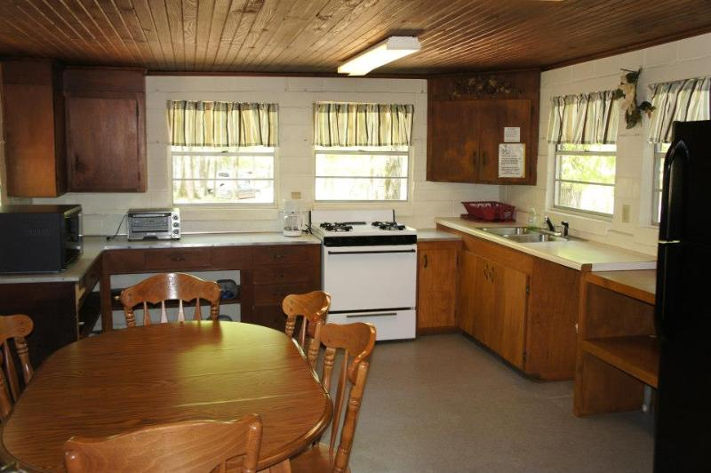 Spacious kitchen with all utensils, pots, pans and flatware.